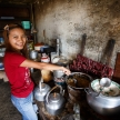 Girl cooking Burmese food in Falam, Myanmar (Burma)