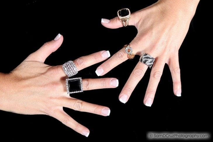 Hands Wearing Luxury Rings