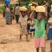 DR CONGO - NOV 2ND : Refugees cross from DR Congo into Uganda at