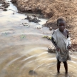 Poor Child - Abuket River, Uganda, Africa
