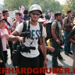 Photographer In Action At Bangkok Protests